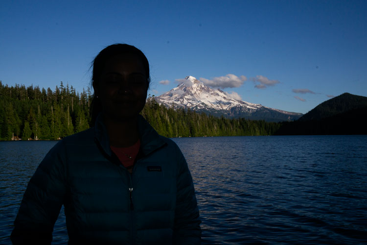 Second composition of silhouetted model looking at Mt. Hood from Lost Lake, Oregon.