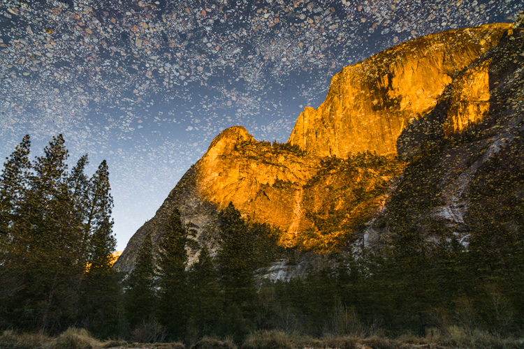 Reflection of Half Dome from the water of Tenaya Creek.