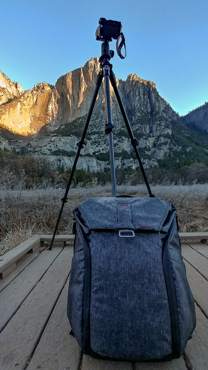 Lower Yosemite Falls with camera on tripod and backpack in the foreground