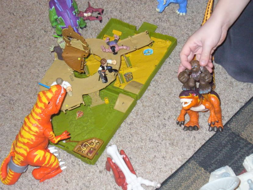 Playing with the kids star wars and dinosaur toys