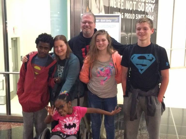 Family of Six at the Indianapolis Airport. Welcome Home Weldu