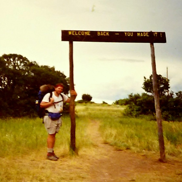 Todd Bussey at the Welcome Back sign at Philmont Scout Ranch, 1990