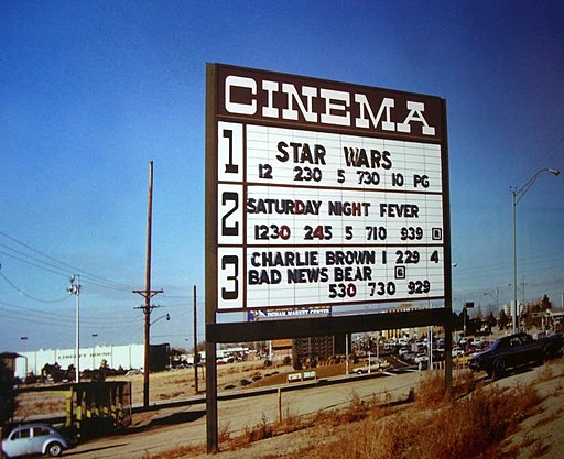 Cinema marquee from 1977. Check out the movies that were showing.