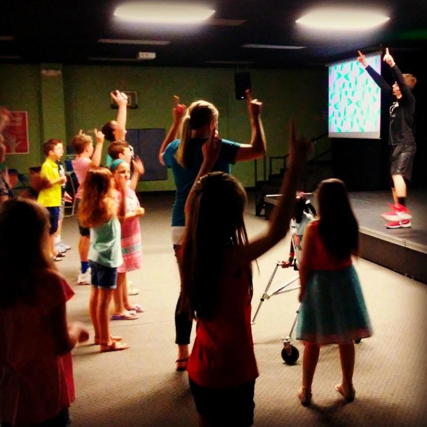 Aiden leading children's worship