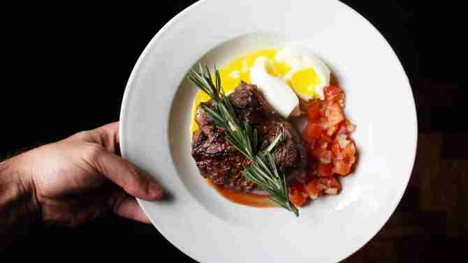 This Is A Plate Of Steak, Eggs, And Tomatoes.