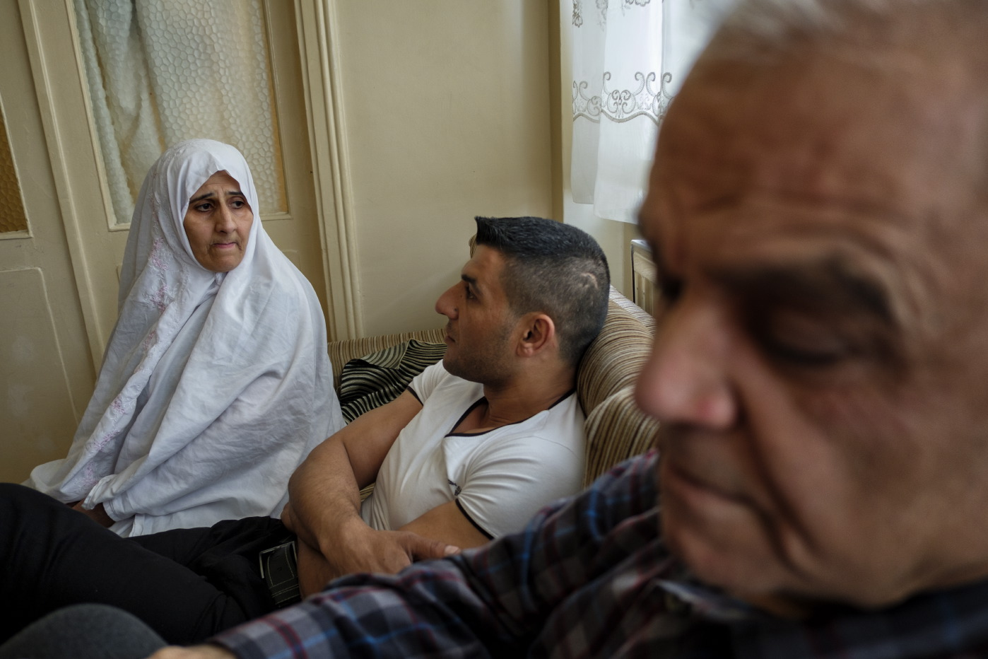 39-year-old award-winning Syrian bodybuilder, Ibrahim Shehabi, is seen with his parents, Radwan and Nadia. After being detained and tortured for 30 months in a prison in Aleppo, Ibrahim moved with his family to Turkey, where they have been living for more than two years. Istanbul, Turkey 2016. © Matteo Bastianelli