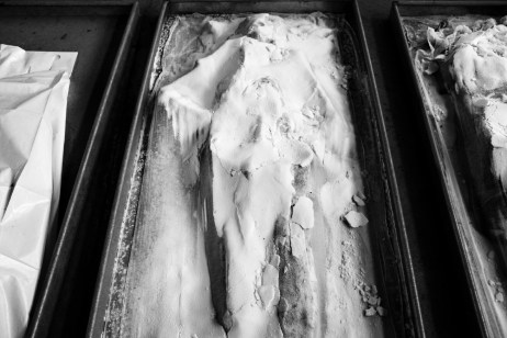A corpse covered in salt, to slow down decomposition, inside the morgue of the Krajina Identification project. The victim was found along with other 434 human bodies in Tomasica, one of the largest mass graves ever found in Bosnia. Sanski Most, Bosnia and Herzegovina, 2014. © Matteo Bastianelli