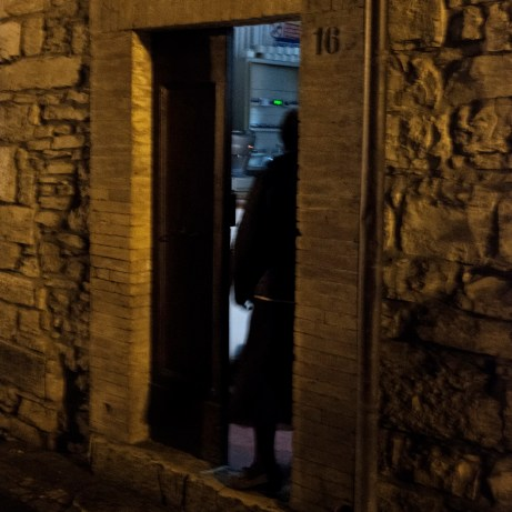 A woman on her doorstep. According to technicians from the Civil Protection Department, there are about 40000 displaced persons by the earthquake. Castelsantangelo sul Nera, Italy 2016. © Matteo Bastianelli