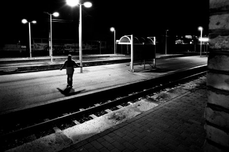 Patrizia is seen between the rails pretending to be an angel. Velletri, Italy 2009. © Matteo Bastianelli