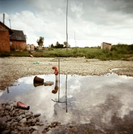 A pump to drain stagnant water at a Rom camp-site in Trnovec Bartolovečki (Varazdin), Croatia 2009. © Matteo Bastianelli