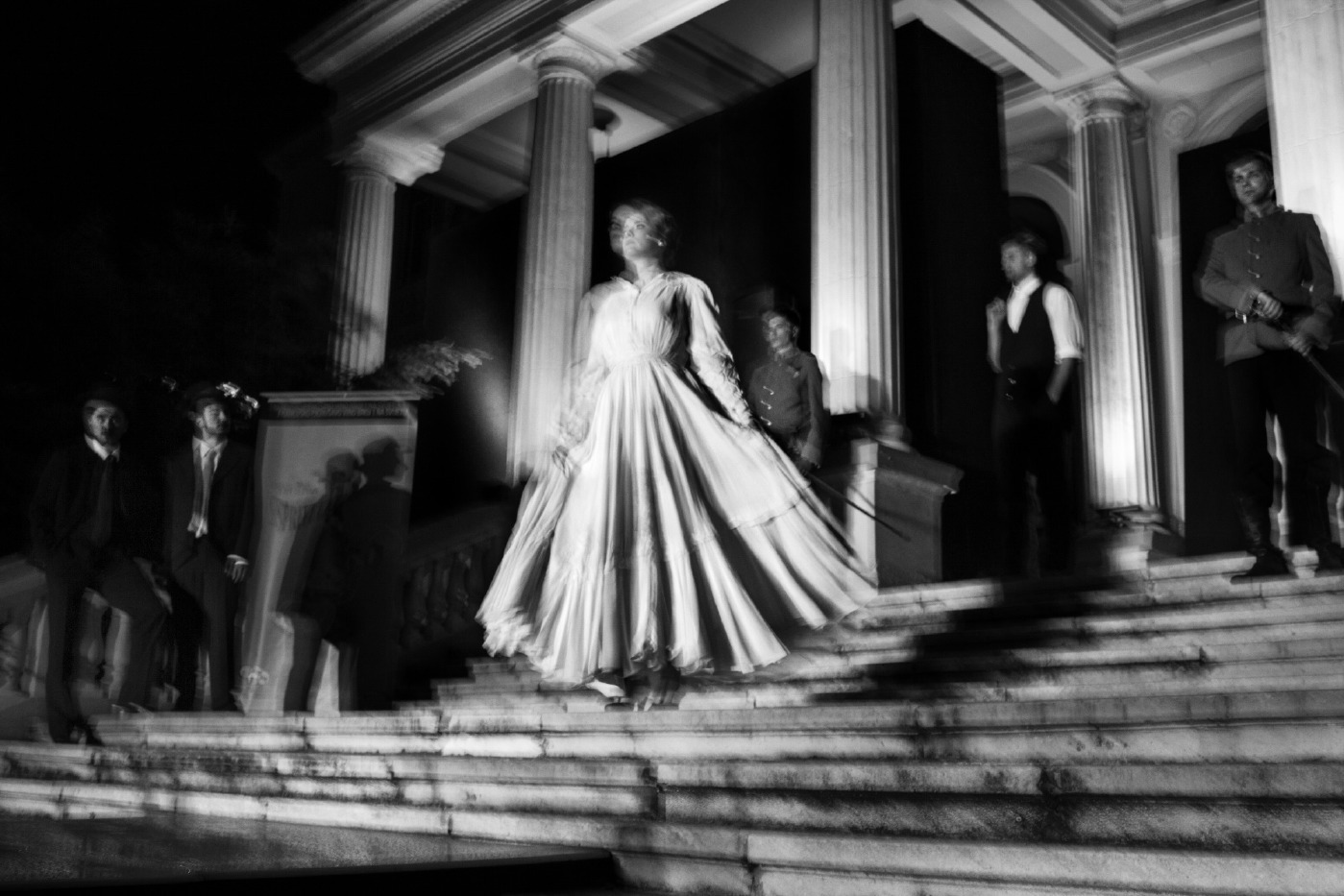 """A model is seen during the fashion performance """"Sarajevo assassination"""", wearing old-fashioned dress of the period 1914-1918. Sarajevo, Bosnia and Herzegovina 2014. © Matteo Bastianelli"""