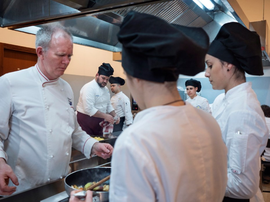 The chef Samuel Rainey while coordinating his students in a cookery laboratory for a re-visitation of traditional Sardinian receipts, during the inauguration of the first world longevity school. Assemini, Italy 2015. © Matteo Bastianelli