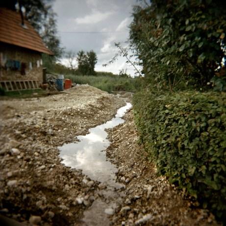 A tiny watercourse used by Rom families for their house-hold chores. Trnovec Bartolovečki (Varazdin), Croatia 2009. © Matteo Bastianelli