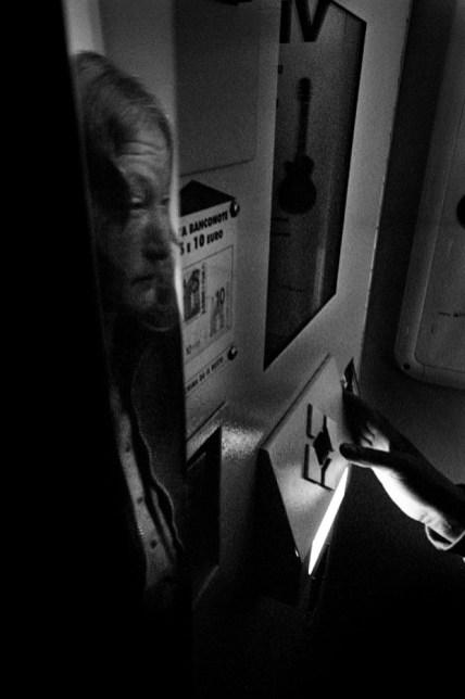 Patrizia inside a photo booth. Velletri, Italy 2009. © Matteo Bastianelli