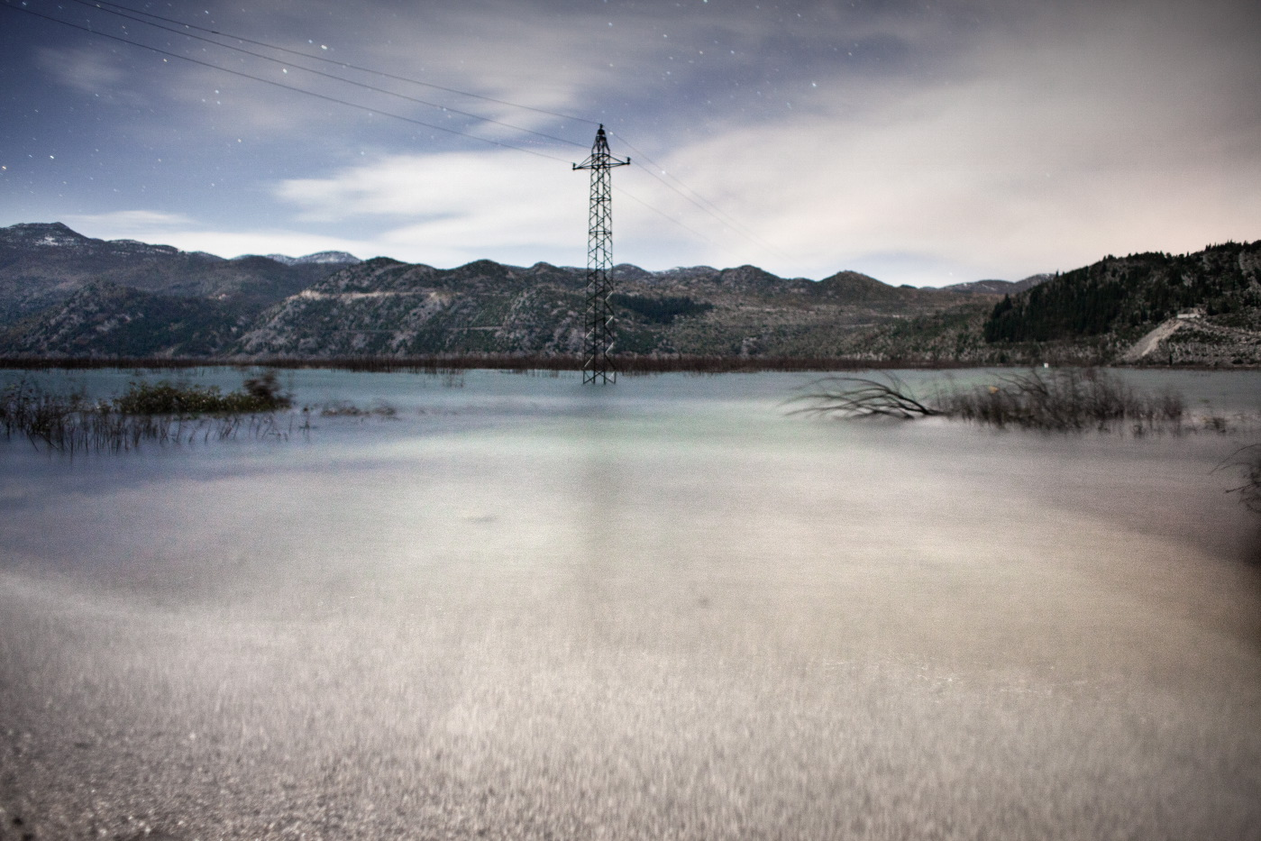 """A pylon stands in the middle of the """"new lake"""". Ravno, Bosnia and Herzegovina 2010. © Matteo Bastianelli"""