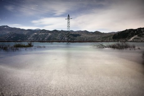 "A pylon stands in the middle of the ""new lake"". Ravno, Bosnia and Herzegovina 2010. © Matteo Bastianelli"