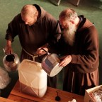 Two friars are seen preparing food and drink to be distributed to the displaced people of the town, accommodated in the municipal sport building turned into a shelter centre. According to technicians from the Civil Protection Department, there are about 40000 displaced persons by the earthquake. Camerino, Italy 2016. © Matteo Bastianelli