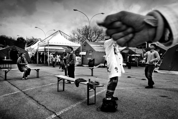 With the help of psychologists and clowns, always ready to put a smile on children's and their parent's faces, the population is slowly trying to return to normality. L'Aquila, Italy 2009. © Matteo Bastianelli