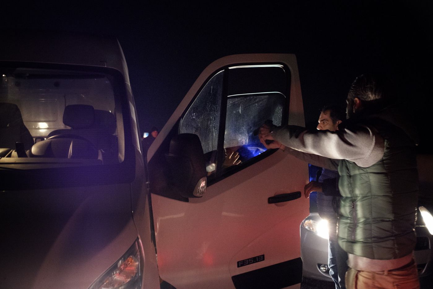 Some members of the Counter-narcotics Group (G.O.A.) in the tax unit of the Lecce financial police, led by the commander of the Organized Crime Investigation Group (G.I.C.O.), are seen pointing their guns at a van driver suspected of carrying marijuana. Carovigno (Brindisi), Italy 2016. © Matteo Bastianelli