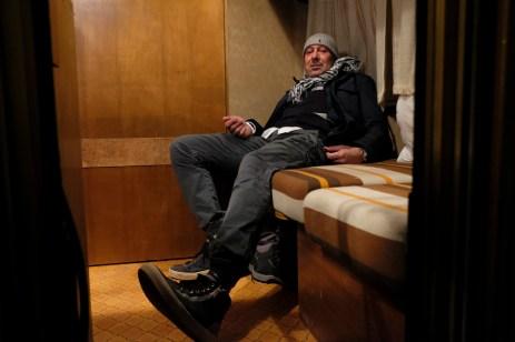 "50-year-old Romeo Tilesi is seen inside his caravan. Amatrice, Italy 2016. © Matteo Bastianelli for ""La Stampa"""