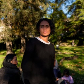 A young man at a public garden along with other displaced persons. Norcia, Italy 2016. © Matteo Bastianelli