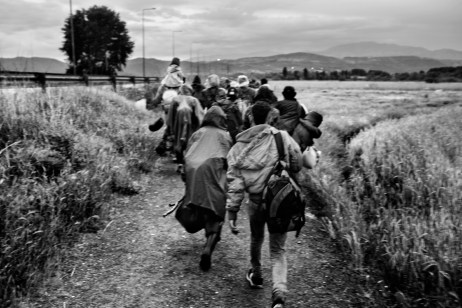 A group of about 6o Syrians, including women and children, on their way to the border between Greece and Slav-Macedonia. Evzoni, Greece 2015. © Matteo Bastianelli