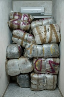 330 kilos of marijuana seized by the members of the Counter-narcotics Group (G.O.A.) in a counter-narcotics operation. Every bag, well wrapped by traffickers to prevent the contents from getting wet during the sea crossing, is labelled with sorting information. Lecce, Italy 2016. © Matteo Bastianelli