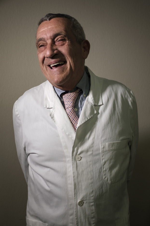 """Doctor Paolo Poli, head physician of the pain therapy unit of Pisa hospital, is seen in his consulting room at the """"Casa di Cura San Rossore"""" facility. He prescribes Bediol and Bedrocan to more than 2000 Italian and foreign adult patients, while giving Bedrolite, a non-psychoactive variety of the medicine, to his younger patients. Pisa, Italy 2016. © Matteo Bastianelli"""