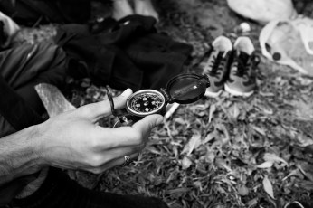 30-year-old refugee Gasmann, from the city of Deir ez-Zur, Syria, reading a compass bought for 90 euro. Thessaloniki, Greece 2015. © Matteo Bastianelli