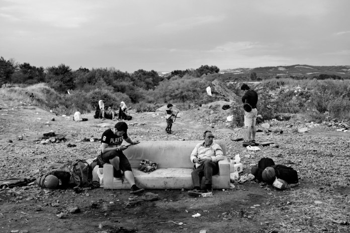 Some refugees are seen waiting to be allowed by FYROM border police to enter the country. Idomeni, Greece 2015. © Matteo Bastianelli
