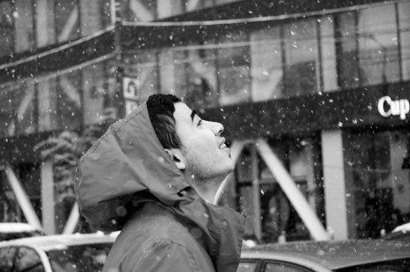 21-year-old Syrian refugee Mohamad Al Masalmeh enjoy a winter snowfall before to continue is journey and try to reach illegally Germany. Bucharest, Romania 2014. © Matteo Bastianelli