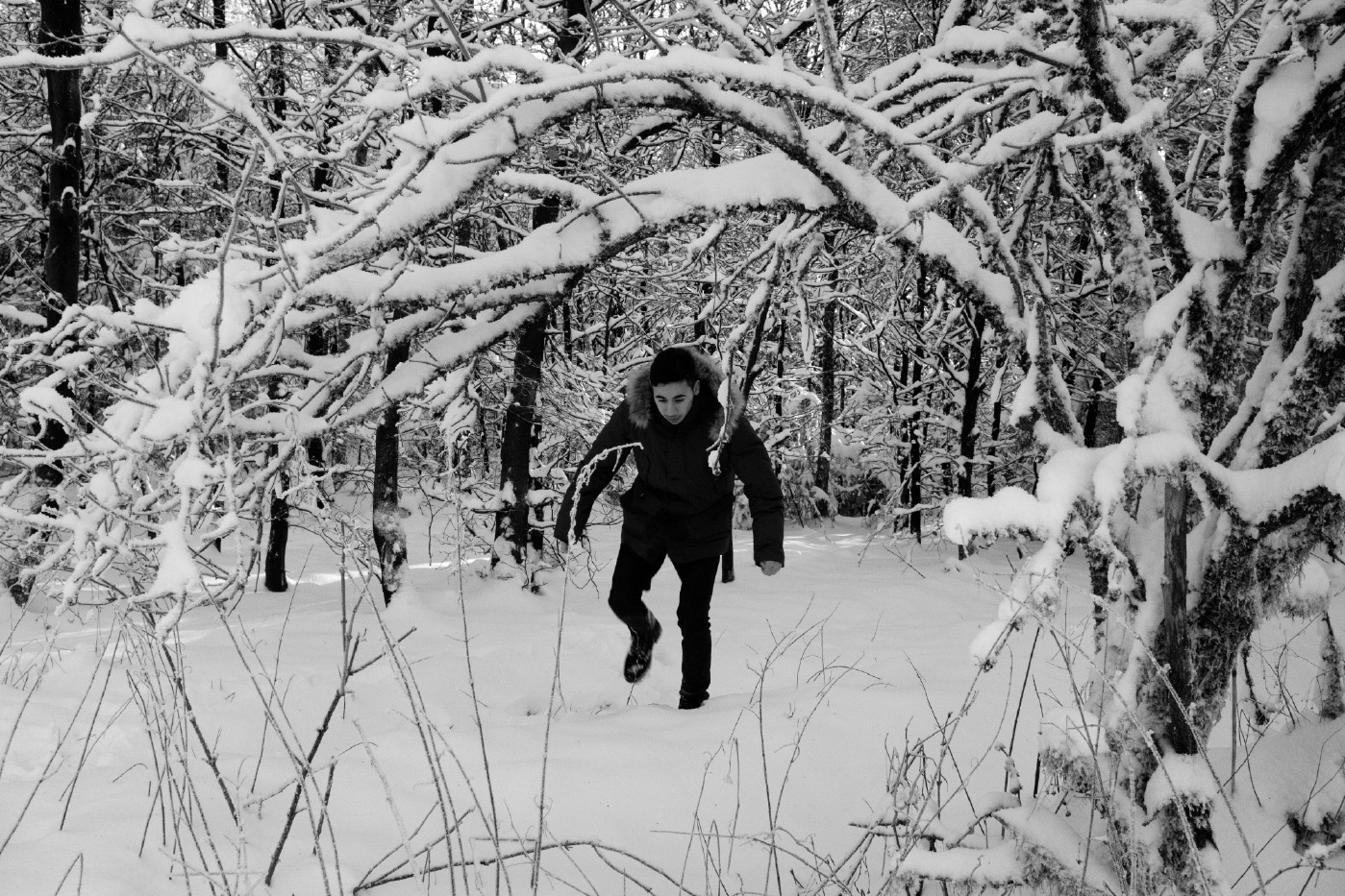 "23-year-old Syrian refugee Mohamad Al Masalmeh walks along a path in the natural park of the Arnsberg forest. ""It's beautiful here, but it reminds me too much of the forest between Romania and Hungary, a real nightmare"", Mohamad claims. In fact, a year earlier, he had to pay a smuggler and walk through the snow for hours before he could catch a train to reach Germany. Warstein, Germany 2016. © Matteo Bastianelli"