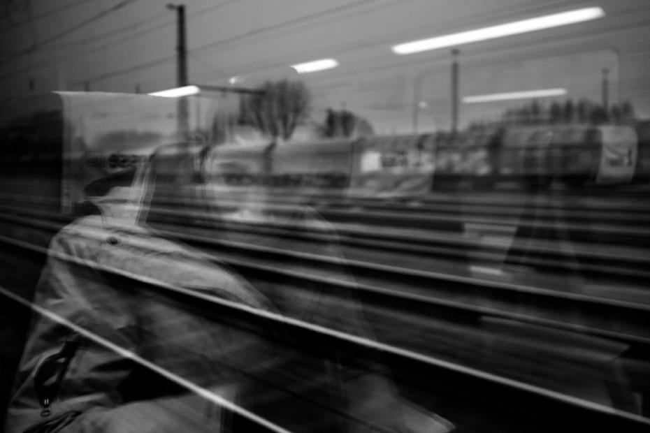 21-year-old Syrian asylum seeker Mohamad Al Masalmeh on the train from Dortmund to Soelst. Dortmund, Germany 2014. © Matteo Bastianelli