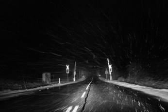 Snow falling at night on a level crossing on the way from Soest to Warstein. Warstein, Germany 2016. © Matteo Bastianelli