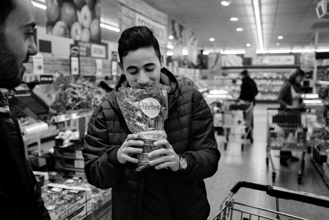 Syrian refugees Mohamad and Hani Al Masalmeh, both resident in Germany, buy spices at the supermarket. Warstein, Germany 2016. © Matteo Bastianelli