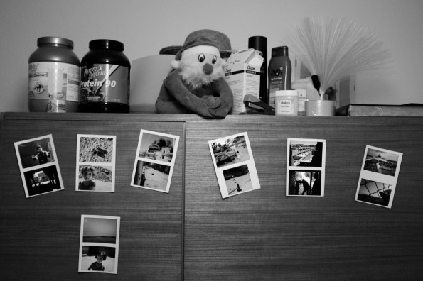Some pictures hanging on Mohamad and Hani's wardrobe. The photographs were taken during the conflict in Syria and after Mohamad escaped: his dream is to become a reporter. Belecke (Warstein), Germany 2016. © Matteo Bastianelli