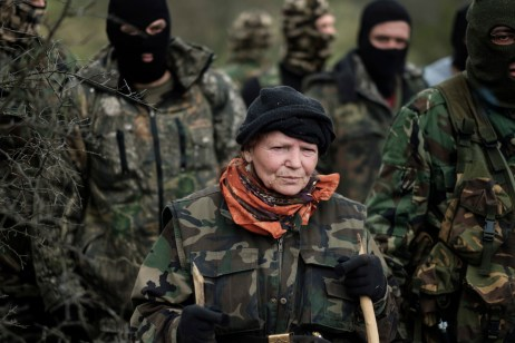 "Siliane, a 67-year-old Bulgarian woman, is seen with the other volunteers from the ""Vasil Levski"" Bulgarian Military Veterans Union and from the ""BNO Shipka"" patrolling a forest, about 30 kilometers from the border with Turkey. Yasna Polyana, Bulgaria 2017. © Matteo Bastianelli"