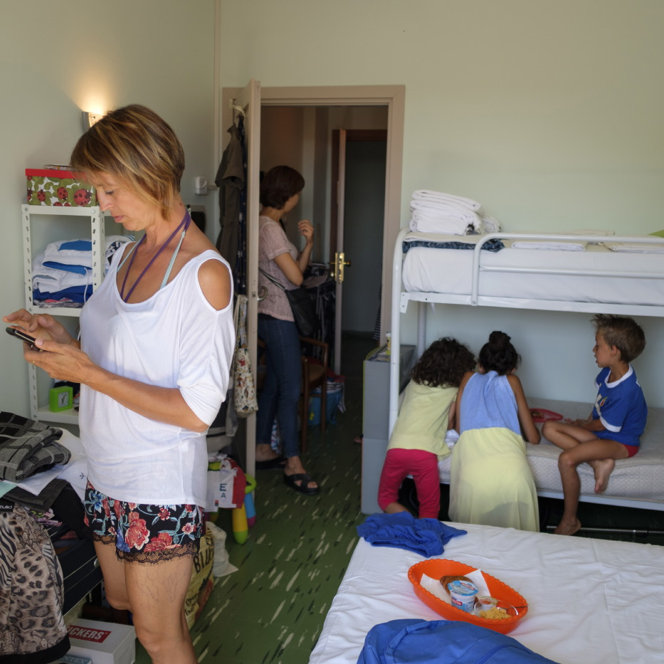 A scene of everyday life inside a room of the Marconi hotel where about 90 earthquake victims are staying. Grottammare, Italy 2017. © Matteo Bastianelli