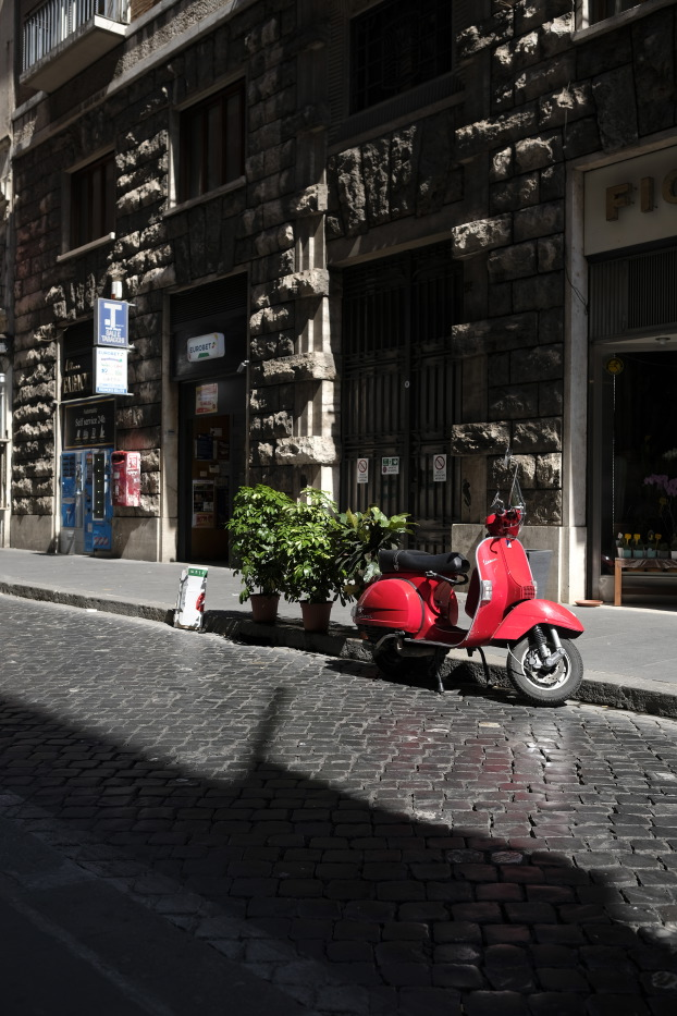 "A Vespa parked near ""La Tabaccheria"", located in Mercede street, one of the places which have been the object of a preventive confiscation order during the ""Babylonia"" operation, that on 23 June 2017 culminated in the arrest of 23 people and in the seizure of assets for a value of € 280 million. Rome, Italy 2017. © Matteo Bastianelli"