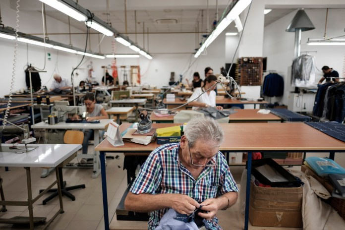 Some tailors at work at the Sartoria Sabino workshop, where the Neapolitan sartorial tradition, in the course of three generations, has been able to adapt to the passing of time and to the changes of fashion. Casalnuovo, Naples, Italy 2017. © Matteo Bastianelli