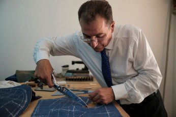 The master Ciro Zizolfi is seen busy cutting textiles for the making of a tailored suit. Pupil of masters Ciro Palermo and Claudio Attolini, Ciro Zizolfi perpetuates the traditional craft, solely by hand, of his sartorial creations. Naples, Italy 2017. © Matteo Bastianelli