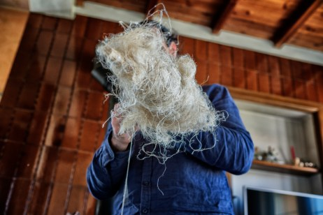 Eugenio Durante, hemp-grower for the past five years, is seen spinning raw hemp fiber in his home. Eugenio, along with his brother Leonardo, has been experimenting with the use of hemp for the realization of handmade fabrics, paper and building materials. Bassano Romano (Viterbo), Italy 2016. © Matteo Bastianelli