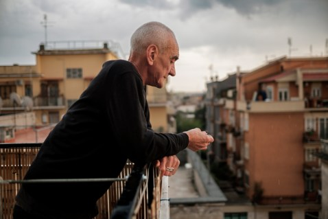 65-year-old Pierluigi Tomassini, is seen on the balcony of his flat. In 2016 the financial police (GDF) seized his marijuana plantation that he wanted to use for therapeutic purposes. Pierluigi had two tumors and uses cannabis with regular medical prescription but he cannot buy the one sold by pharmacies at 16 euro per gram. Rome, Italy 2017. © Matteo Bastianelli