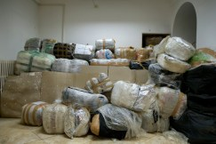Around 4 tonnes of marijuana, well wrapped by traffickers to prevent it getting wet during transport by sea from Albania and seized in a counter-narcotics operation, are seen stored at the local control office of the Guardia di Finanza (Financial Police) in Lecce, Italy 2016. © Matteo Bastianelli