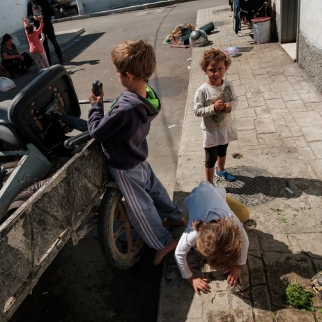 Some kids play around a motorcycle cart used to collect items picked from the trash to be resold. Child marriage affects girls in far greater numbers than boys. According to Save the Children, every year, 12 million girls and young women throughout the world marry before the age of 18. Tirana, Albania 2019. © Matteo Bastianelli