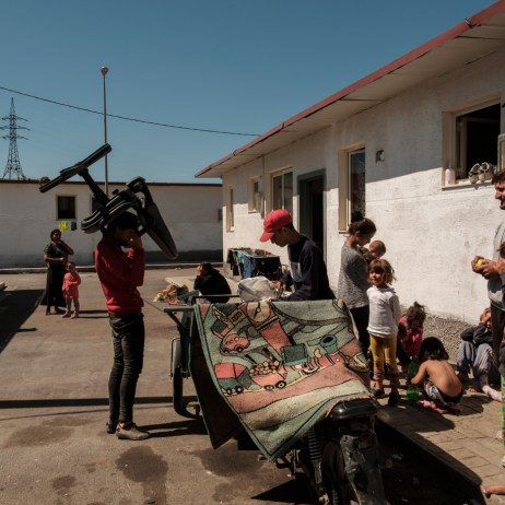 Young men and girls are seen playing around a motorcycle cart used to collect items picked from the trash to be resold by waste pickers living in the community. Child marriage affects girls in far greater numbers than boys. According to Save the Children, every year, 12 million girls and young women all over the world marry before the age of 18. Tirana, Albania 2019. © Matteo Bastianelli
