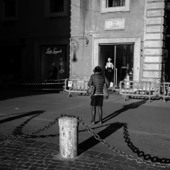 Daily life scenes in the half-empty streets of the city centre. Following the new Prime Ministerial Decree of 11 March 2020, allcommercial activities will be closedexcept for pharmacies, parapharmacies, newsstands, tobacconists, food and basic necessities stores. Rome, Italy 2020. © Matteo Bastianelli