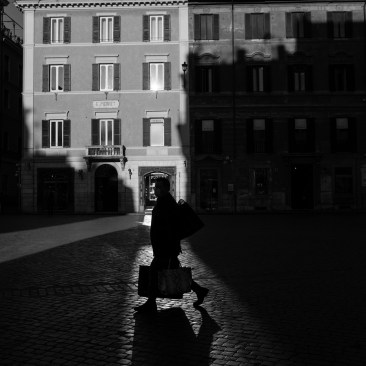 """A man wearing a mask, walks through the half-empty streets of the city centre on the day that the World Health Organization (WHO)declaredthe Coronavirus outbreak apandemic. Following the dispositions of the Prime Ministerial Decree """"I stay home"""", people shouldstay home except forwork needs, situations of necessity and health reasons. Rome, Italy 2020. © Matteo Bastianelli"""