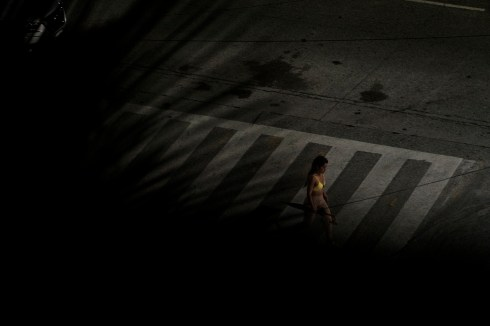 A woman is seen crossing a street in the city center at night. The United Nations say that 4 of every 10 Mexican women will experience sexual violence, such as unwanted groping or rape, during their lifetimes, and that 9 women are murdered on average every day in the country. Acapulco, Mexico 2019. © Matteo Bastianelli