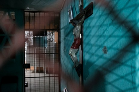 A crucifix hanging in the church of a rural congregation outside the city, where priest Jesus Mendoza was transferred for his own protection, after serving for years at a church in the violent port city of Acapulco. According to the Catholic Multimedia Center (CCM), 27 priests had been killed in Mexico since 2012, making the country the most dangerous place in Latin America for priests. Acapulco, Mexico 2019. © Matteo Bastianelli